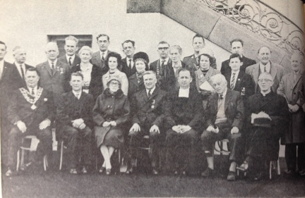 Commemoration of Thomas Ashe in De La Salle College, 22 April 1966. Middle Row: 5th from left; Eileen Quinn (daughter of Gregory Ashe), 6th from left; Eileen Ashe (niece), 4th from right; Bridie Ashe (Norris), 3rd from right; Sean Ashe (grandnephew). Front Row: 2nd from left; Patrick Ashe (nephew), 3rd from left; Nora Ashe (sister), 2nd from right; Gregory Ashe (brother)